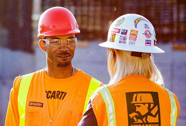 Male and Female Craft Construction Workers Talking Together