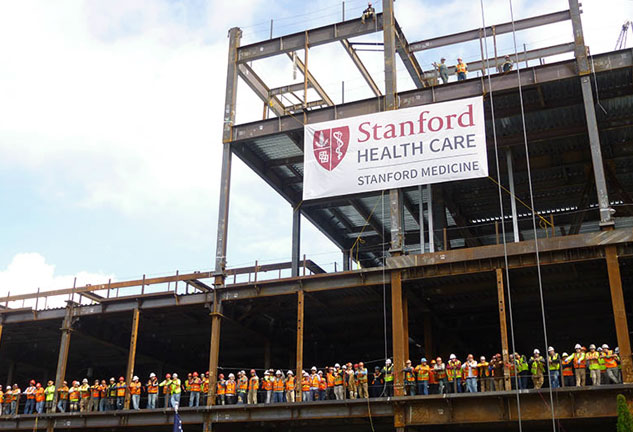 Group photo of construction staff at construction site for new Stanford Hospital