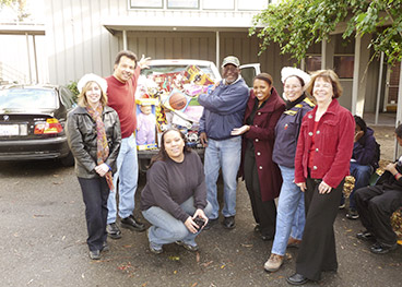 McCarthy staff volunteering to collect toys for children near job site.