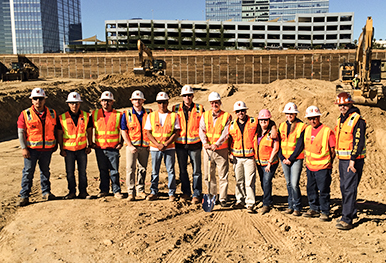 Group photo of a team of construction workers on site