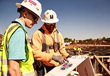 Construction workers looking at a document