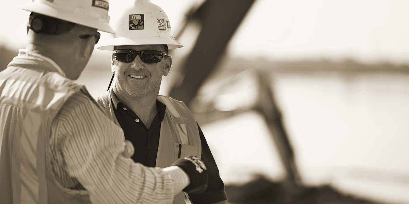 McCarthy employee discussing the project with a client on site.