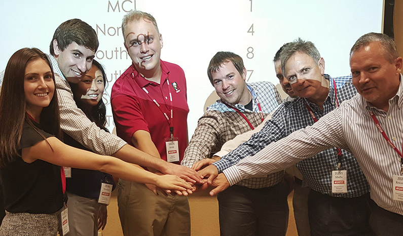 McCarthy team members attend a training to focus on teamwork.
