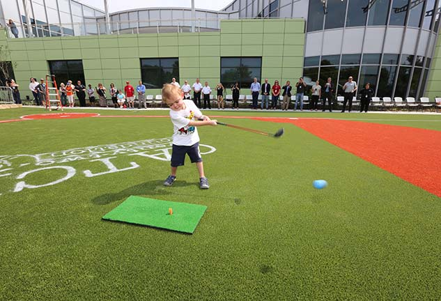 Young boy golfing at Ranken Jordan Pediatric Bridge Hospital