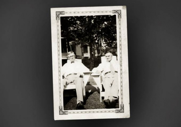 John W. and Timothy McCarthy sitting in chairs