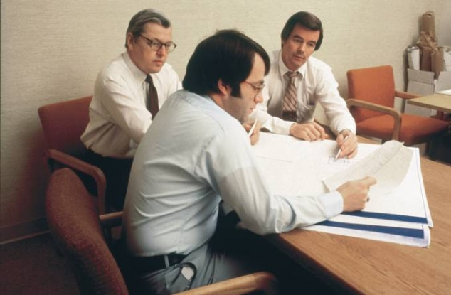 McCarthy employees sitting at desk looking at plans