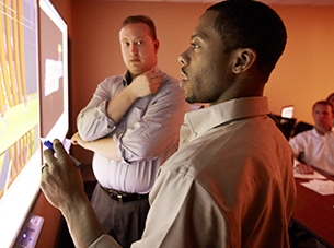 two men looking at computer screen