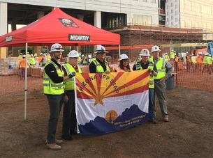 Construction workers holding banner