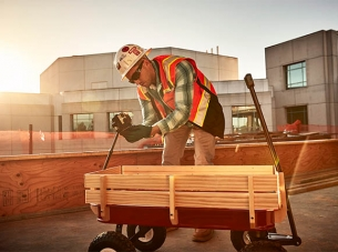 Construction Worker with Wagon and Digital Camera