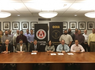 McCarthy Houston office employees meeting with representatives of OSHA