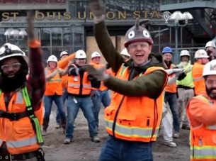 construction workers dance to the baby shark song