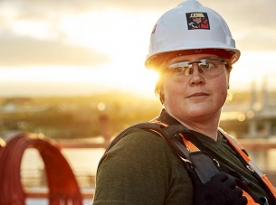woman in hard hat and safety goggles