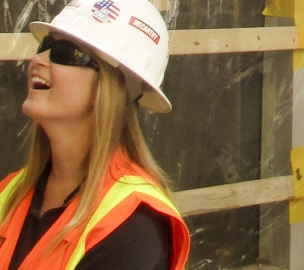 Lindsay Johnson smiles while on a construction site.