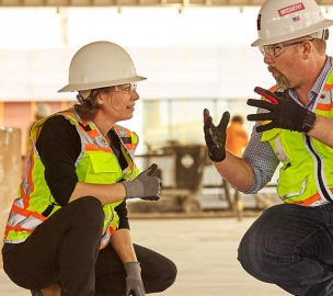 Woman and Man Construction Worker Collaborating