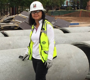 Woman Construction Worker with Concrete Pipe