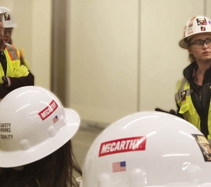 Women wearing McCarthy Building Companies Hard Hats