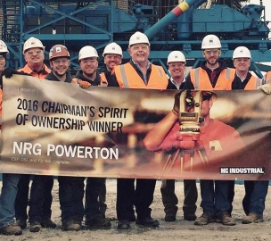 Group of Construction Workers hold 2016 Chairman's Spirit of Ownership Winner Banner