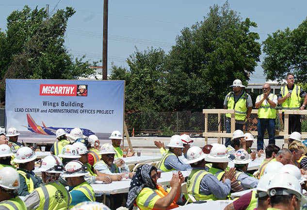 "McCarthy team celebrates topping out of ""Wings"" building for Southwest Airlines"