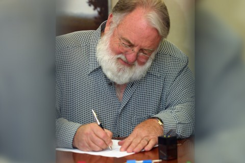 Mike McCarthy signing papers
