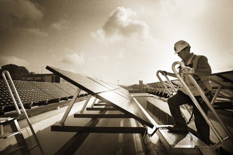 Solar panels and a McCarthy construction worker